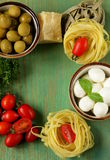 Italian still life - olives, mozzarella cheese, pasta Royalty Free Stock Photos