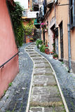 Italian street. An Italian street with a stepped path leading to a pizzeria Stock Photo