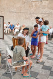 Italian street artist and tourists Stock Image