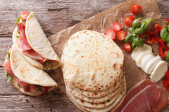 Italian street food: piadina with ham, cheese and vegetables clo Stock Images