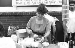 Italian street party, Clerkenwell. A woman ladles strawberries at the Italian street party in Warner Street, Clerkenwell, London on July 21, 1990. The event Royalty Free Stock Photography