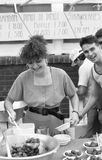 Italian street party, Clerkenwell. A woman ladles strawberries at the Italian street party in Warner Street, Clerkenwell, London on July 21, 1990. The event stock photos