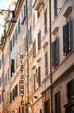 Italian street. Urban Italian street in Rome with Restaurant sign Royalty Free Stock Photo