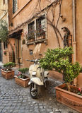 Italian street with Vespa Royalty Free Stock Photo