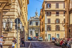 Italian Street Via di S. Claudio and the Church of SS. Claudius and Andrew of the Burgundians. Rome/Italy - August 26, 2018: Italian Street Via di S. Claudio and royalty free stock images