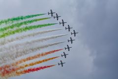Airshow with Jetplanes and smoke. Italian stuntteam performing a show in the netherlands stock image