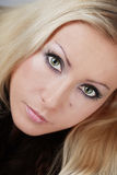 Italian style. Close-up portrait of beautiful blond woman with professional smoky eyes makeup Royalty Free Stock Image