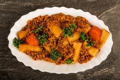 Italian Style Beef and Chianti Ragu Pasta Meal. Against A Black Background Royalty Free Stock Photos
