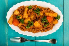 Italian Style Beef and Chianti Ragu Pasta Meal. Against A Blue Background Stock Photos