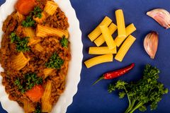 Italian Style Beef and Chianti Ragu Pasta Meal. Against A Blue Background Stock Photography