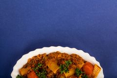 Italian Style Beef and Chianti Ragu Pasta Meal. Against A Blue Background Stock Image
