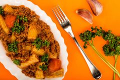 Italian Style Beef and Chianti Ragu Pasta Meal. Against An Orange Background Royalty Free Stock Image