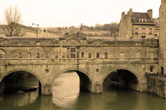 Italian style bridge in Bath city in sepia color. Italian style bridge over Avon river in Bath city, England. Pultney Bridge built in 1773 Stock Photos