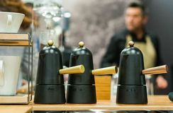 Italian style coffee maker with barman in the background stock photography