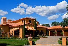 Italian style house. With big clouds over it Royalty Free Stock Photos