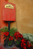 Italian style mailbox with flower. Italian style mailbox in the park Stock Image