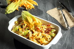 Italian style pasta with zucchini flower Royalty Free Stock Photos