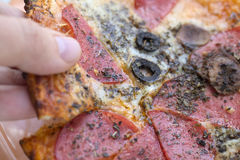 Italian style pizza close-up. Delicious close-up photograph of italian style pizza Royalty Free Stock Images