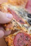 Italian style pizza close-up. Delicious close-up photograph of italian style pizza Royalty Free Stock Image