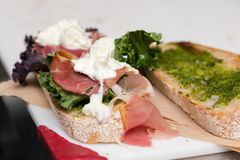 An Italian style sandwich with prosciutto and buffalo mozzarella. stock photo