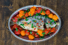 Italian style sea bream in crazy water -  acqua pazza Royalty Free Stock Images