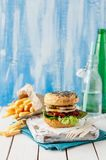 Italian Style Turkey Burger. With French Fries, copy space for your text royalty free stock photo