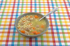 Italian style wedding soup in a bowl with a spoon Royalty Free Stock Photo