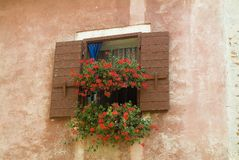 Italian style window of an old seaport building Stock Photo