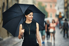 Italian style woman with umbrella Stock Photography