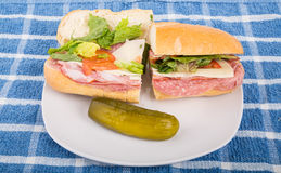 Italian Sub Sandwich with Pickle on Plate Royalty Free Stock Photo