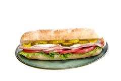 Italian Submarine Sandwich. On a plate with white background and copy space stock photos