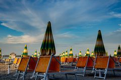 Italian summer on the Adriatic Sea: tyipical italian Riviera Romagnola beach clubs with sunbeds and beach umbrellas with typical stock image