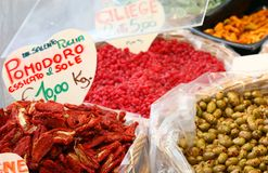 Italian sun-dried tomatoes and candied fruits for sale Royalty Free Stock Image