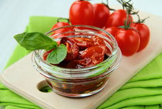 Italian sun dried tomatoes in olive oil. Glass jar Stock Images