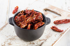 Italian sun dried tomatoes on  white wooden table. Royalty Free Stock Image