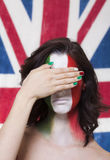 Italian supporter for FIFA 2014 covering her eyes during Italy V. Beautiful italian supporter for FIFA World Cup Brazil 2014 covering her eyes during the round Royalty Free Stock Photography