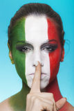 Italian supporter for FIFA 2014 making silence gesture Royalty Free Stock Images