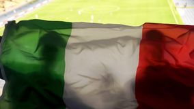 Italian supporters waving national flag, cheering for football team victory. Stock photo stock photography