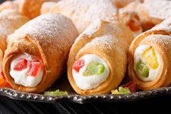 Italian sweet cannoli with cheese cream and candied fruits macro Royalty Free Stock Images
