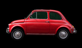 Italian symbol. Side view of a red famous italian car isolated on black Royalty Free Stock Image