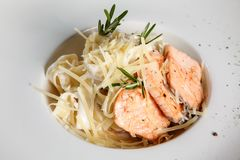Italian Tagliatelle Pasta with fried Salmon Fillet / Pasta with stock photo