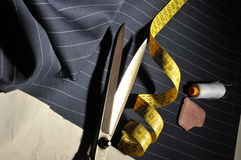 Italian tailoring. Italian fabric with scissors and meter Royalty Free Stock Image
