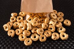 Taralli crackers spilling ou of a paper bag stock photo