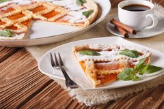 Italian tart with apricot jam and coffee. horizontal Royalty Free Stock Photography
