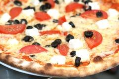 Italian taste. Feta cheese and olives pizza Royalty Free Stock Image