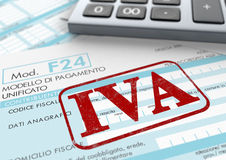 Italian taxes. Close up view of F24 form for italian taxes,the word iva and an electronic calculator (3d render Stock Photos