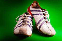 Italian Tennis Shoes. White, red and blue tennis shoes over green background Stock Images