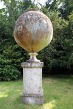 Italian terracotta jar on a column at Hever castle garden in England Stock Image