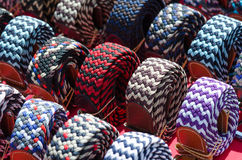 Italian textile waistbands on a desk of a market in Milan Royalty Free Stock Photos