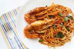 Italian Thai Fusion food spaghetti stir fry with Thai spicy an. Italian Thai Fusion food, Pasta spaghetti stir fry with Thai spicy and sour sauce (Tom Yum Kung royalty free stock image